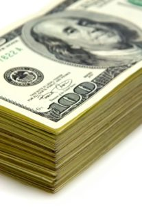 close-up view of stack of one hundred dollar bancknotes